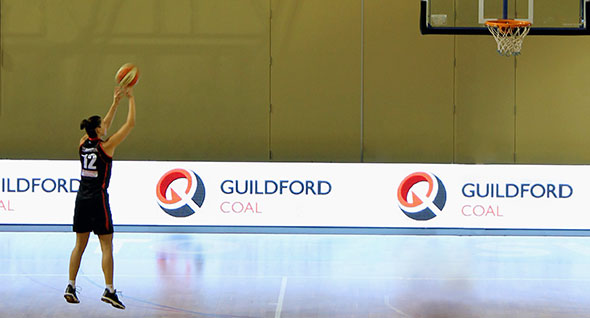 Guildford sponsored player, Kayla Standish, shoots a winner in the opening game of the 2014 WMBL season.